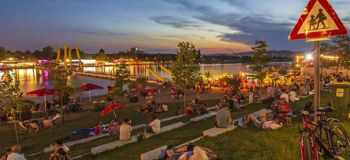 recreational area Copa Beach at river Neue Donau (New Danube), people on meadow, bar, view to Wienerwald Wien, Vienna W