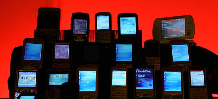 Phones and hadsets are displayed at the 3GSM World Congress in Barcelona