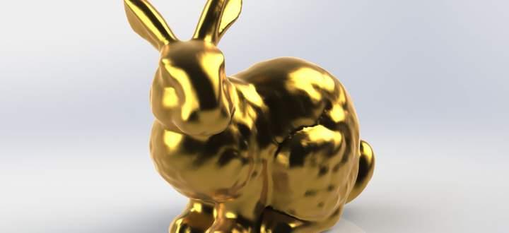 """So sieht der Stanford-Hase (""""Stanford Bunny"""") aus, hier in Gold. Die ETH-Forscher haben ihn aus – scheinbar – schlichtem Kunststoff gebaut."""