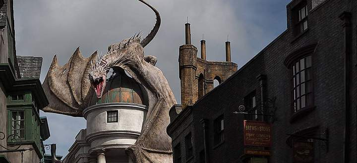 June 19 2014 Orlando Florida U S A dragon perches on top of Gringotts bank at the Wizarding