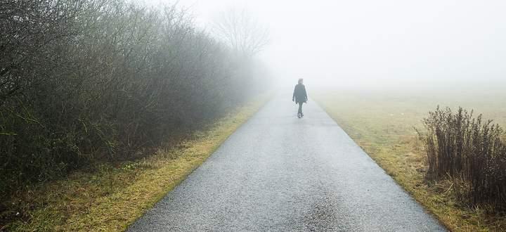 Middle age woman walking in winter landscape