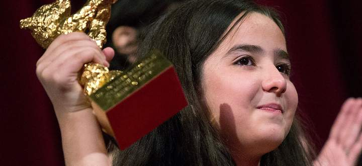 The niece of Iranian film director Panahi accepts the Golden Bear for Best Film on her uncle's behalf during awards ceremony at 65th Berlinale International Film Festival in Berlin