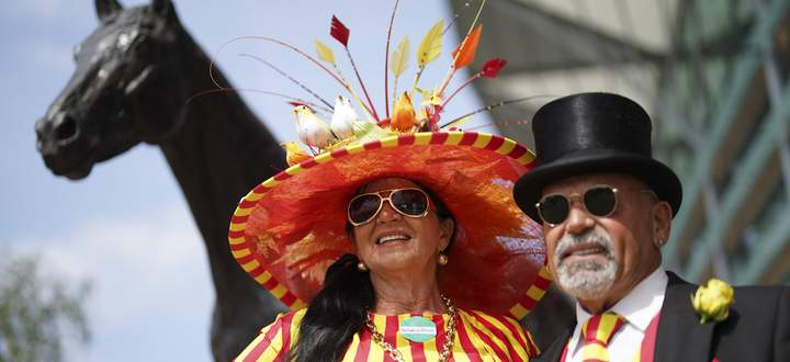 Mandatory Credit: Photo by Jed Leicester/BPI/Shutterstock (12074675p) Red and Yellow striped attire for race goers on Da