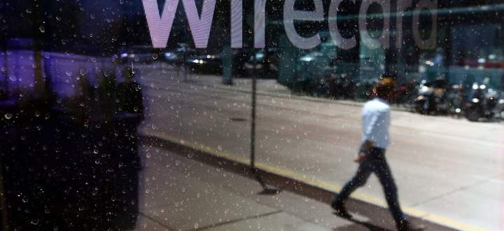 Archivbild: Spiegelung am Eingang zu einem Wiener Wirecard-Standort