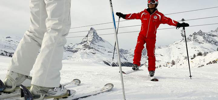 Chinese ski instructor Li exercises with a client during a private beginner ski course in the alpine resort of Zermatt