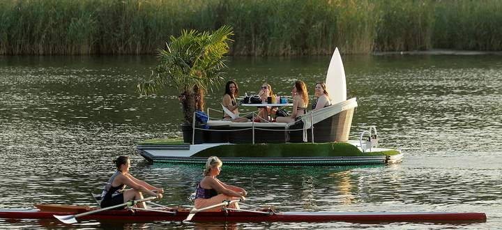People enjoy a hot summer evening at a former river Danube side arm in Vienna