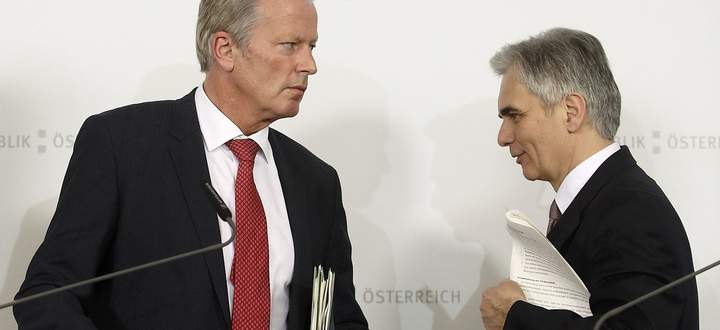 Vice Chancellor Mitterlehner and Chancellor Faymann leave a news conference after the end of a government conclave in Krems