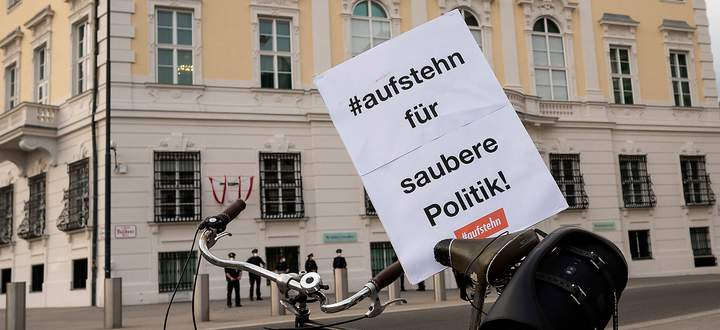 20210401 Flashmob - Easter cleaning for cleaner politics at the Federal Chancellery VIENNA, AUSTRIA - APRIL 1: Flashmob