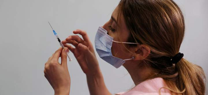 FILE PHOTO: A medical worker prepares to administer a second vaccination injection against the coronavirus disease as Israel continues its national vaccination drive