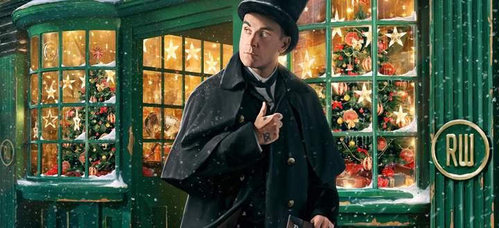 """Weihnachtlich adjustiert: Robbie Williams auf dem Cover von """"The Christmas Present""""."""