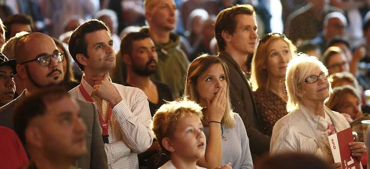 Supporters of the Social Democratic Party (SPOe) react after first exit polls in Vienna