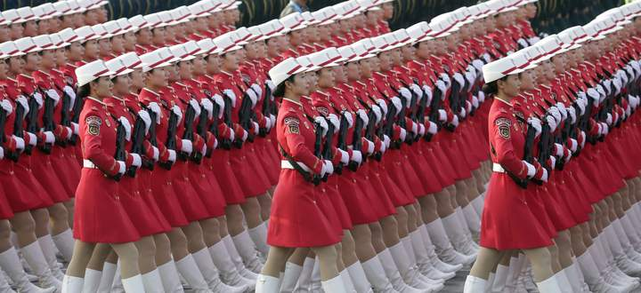 Militia members and soldiers of People´s Liberation Army (PLA) march in formation past Tiananmen Square before a military parade marking the 70th founding anniversary of People´s Republic of China