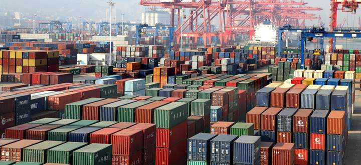 LIANYUNGANG, CHINA - DECEMBER 08: Shipping containers sit stacked at Lianyungang Port on December 8, 2019 in Lianyungan