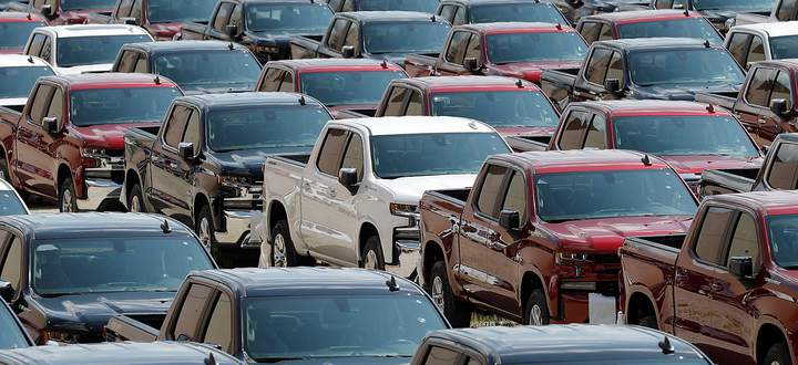 Assembled trucks are ready for delivery at GM's Chevrolet Silverado and GMC Sierra pickup truck plant in Fort Wayne Indiana