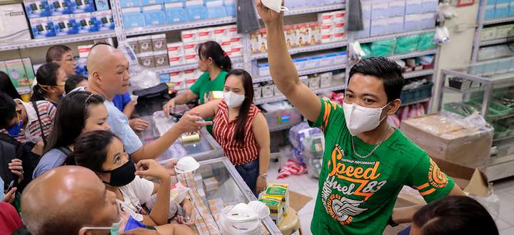 A vendor shows the only type of face mask they have available as people scramble to buy masks in a medical supply store a day after the Philippine government confirmed the first novel coronavirus case, in Manila