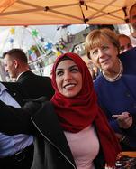 Merkel Visits Local Fest In Stralsund