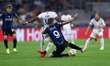 Fc Internazionale - Real Madrid Cf Edin Dzeko of Fc Internazionale and David Alaba of Real Madrid Cf battle for the bal