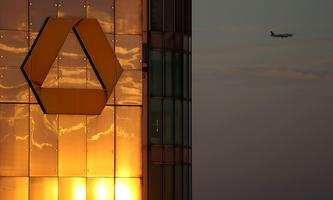 FILE PHOTO: The logo of Germany's Commerzbank is seen in the late evening sun on top of its headquarters in Frankfurt