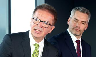 Austrian Health Minister Rudolf Anschober and Interior Minister Karl Nehammer address a news conference in Schwechat