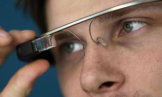 A man adjusts his Google glasses after a media presentation of a Google apartment in Prague