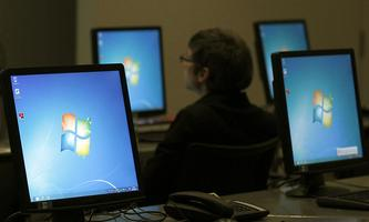 Monitors running Windows are pictured at the press center of the annual news conference of Bayer in Leverkusen
