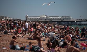 People enjoy the weather around Britain