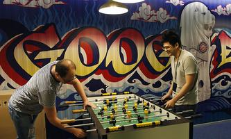 Google´s communications manager Moroney plays table soccer with a Google employee at a recreational area of their Singapore office