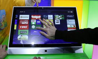 People try out Microsoft Corp´s Windows 8 operating system at an event for its debut at the Akihabara electronics store district in Tokyo