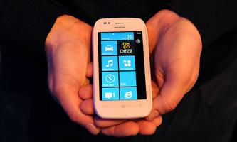 A man holds the new Nokia Lumia 710 smartphone at the Nokia World event in London