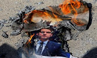 Palestinians protest against the publications of a cartoon of Prophet Mohammad in France and Macron´s comments