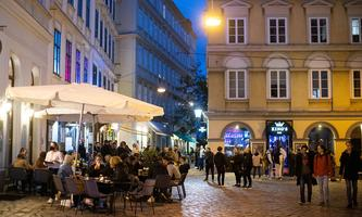 People enjoy an evening drink after Austria eases its COVID-19 restrictions