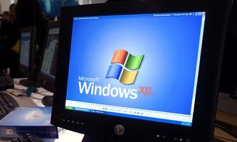 Brian Rose, 10, plays on a Windows XP based personal computer, running the latest version of the com..