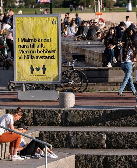 People enjoy the warm evening at Sundspromenaden in Malmo