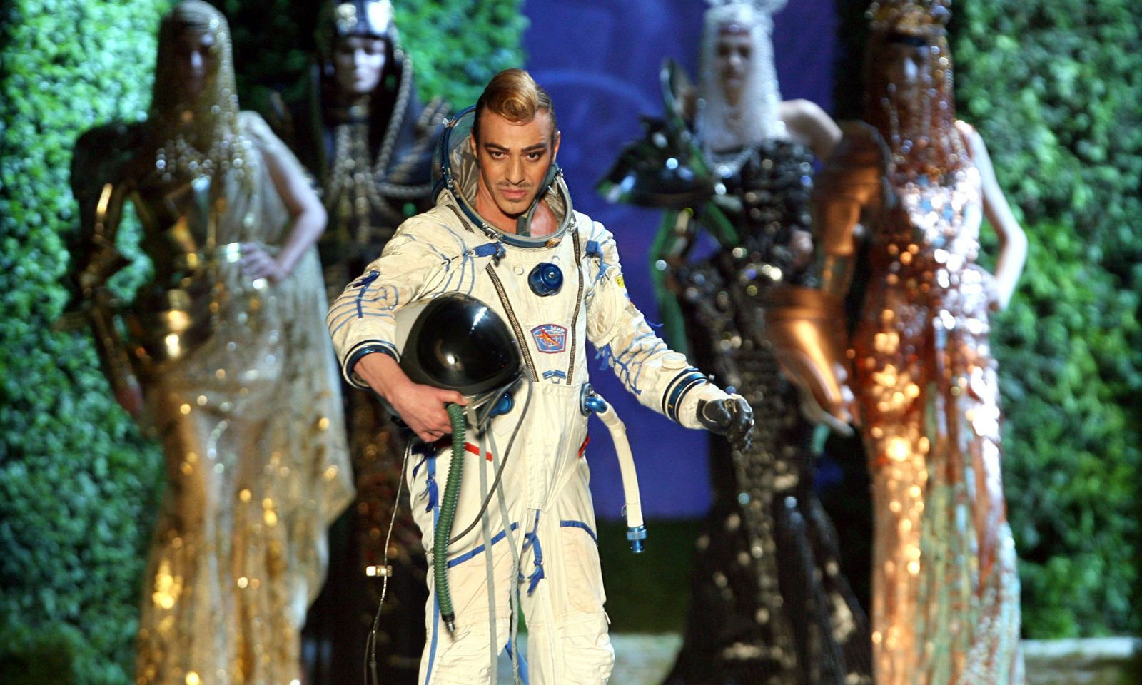 British designer John Galliano for French fashion house Dior wears a space suit at the end of their ..