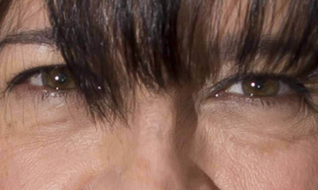 E L James, author of Fifty Shades of Grey, poses for photographers during a book signing in London