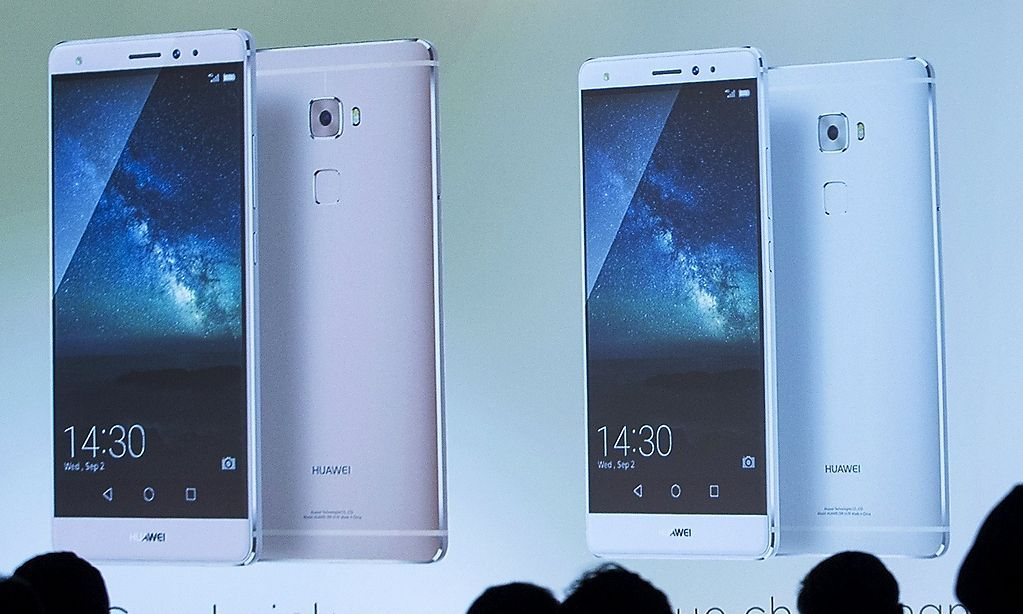 Journalists follow the presentation of Huawei's Mate S ahead of the IFA Electronics show in Berlin