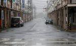 An empty road leading into Shiroko, Suzuka, Japan October 12, 2019, seen in heavy rain ahead of Typhoon Hagibis
