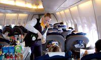 Stewardess im Flugzeug / Stewardess in the airplane