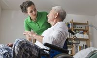 Germany Leipzig Man on wheelchair talking with woman model released property released PUBLICATION