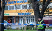 Policemen and paramedic are seen in front of the Ostrava Teaching Hospital, where six persons died after shooting on Tu