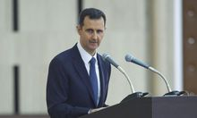 Syria's President Assad delivers a speech while attending an Iftar session in Damascus