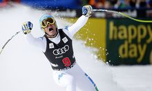Christof Innerhofer of Italy celebrates setting the best time as he skis into the finish area in men's World Cup downhill ski race in Beaver Creek