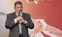 Egypt's President Mursi speaks to supporters in front of the presidential palace in Cairo