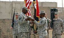 Commanding General of U.S. forces in Iraq, Lieutenant General Austin folds U.S. Forces in Iraq flag d