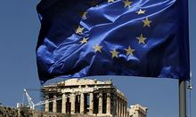 A European Union flag waves above the ancient Parthenon temple, at the Acropolis Hill, in Athens on M