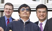 In this photo released by the US Embassy Beijing Press Office, blind lawyer Chen Guangcheng, front le