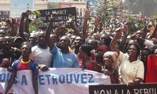 Supporters of Central African Republic President Bozize and anti-rebel protesters chant slogans in Bangui