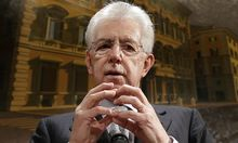 Italy's outgoing Prime Minister Monti gestures during a news conference in Rome