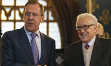Russia's Foreign Minister Lavrov shakes hands with U.N.-Arab League peace mediator Brahimi in Moscow