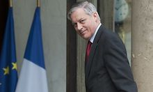Bank of France Governor Noyer arrives to attend a meeting at the Elysee Palace  in Paris